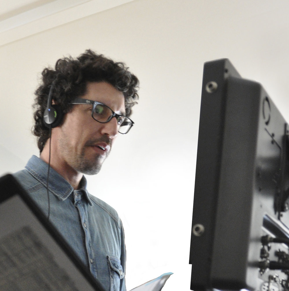 Quincy Rose – Behind the Scenes shot of Writer/Director Quincy Rose at the monitor.