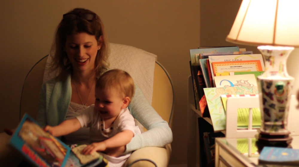 On the Horizon – Liz reads to her daughter Charlotte, using a lamp powered by her new home solar power system.