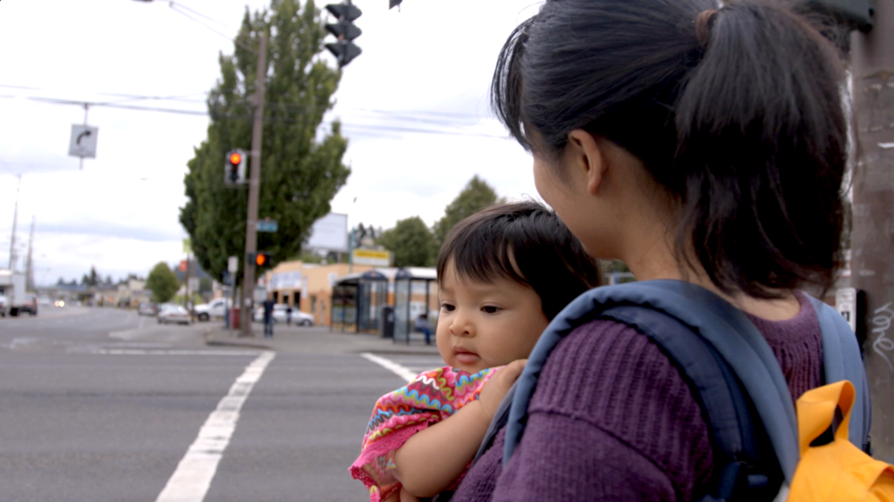 Khanh at corner: Khanh Pham and her daughter at SE 82nd and Division.