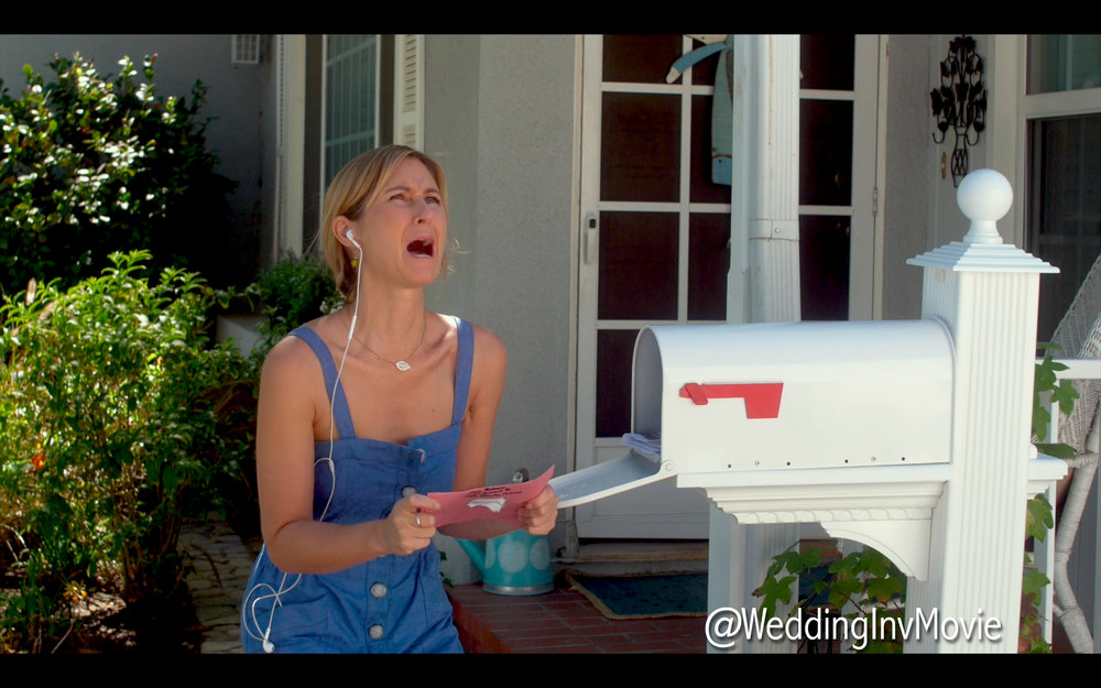 Lucy discovers the wedding invitation stuck to the roof of her mailbox.