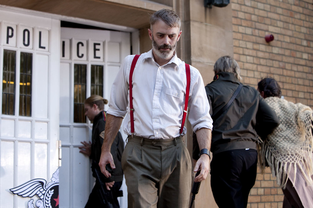 Crime and Punishment - Raskolnikov (Lee Mason) leaves the Police Station.