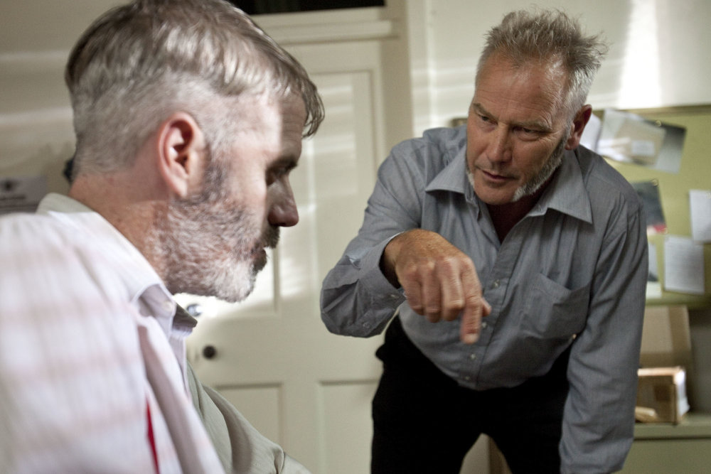 Crime and Punishment - Raskolnikov (Lee Mason) is interrogated by Inspector Porfiry (Christopher Bunworth).