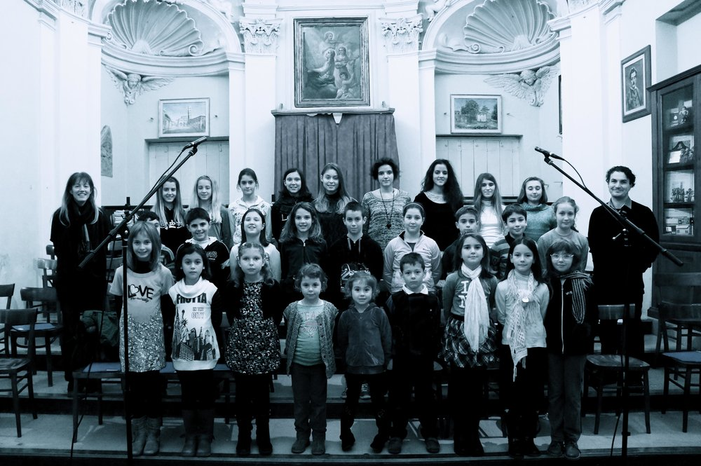 Children's Choir of Cappella Santa Cecilia of Lucca, Italy with Choir Conductor Sara Matteucci and film composer Saverio Rapezzi.