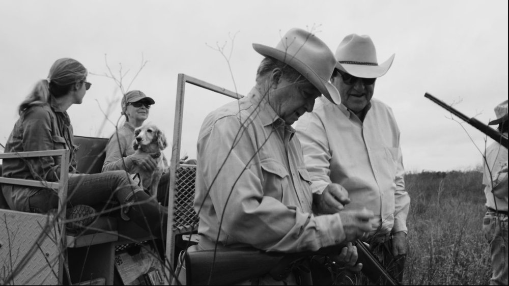 Lavoyger on a hunt with lawyer Dick DeGuerin.