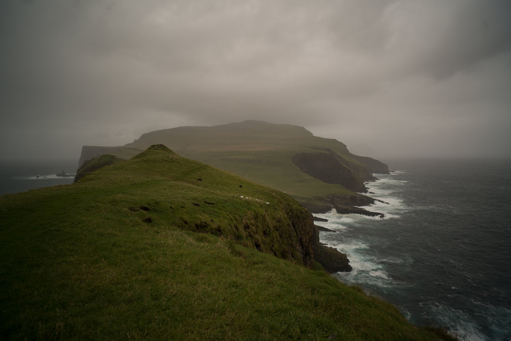 The island of Mikines in the Faroe Islands. The Atlantic swells are so strong that for most of the year the island is only accessible by helicopter