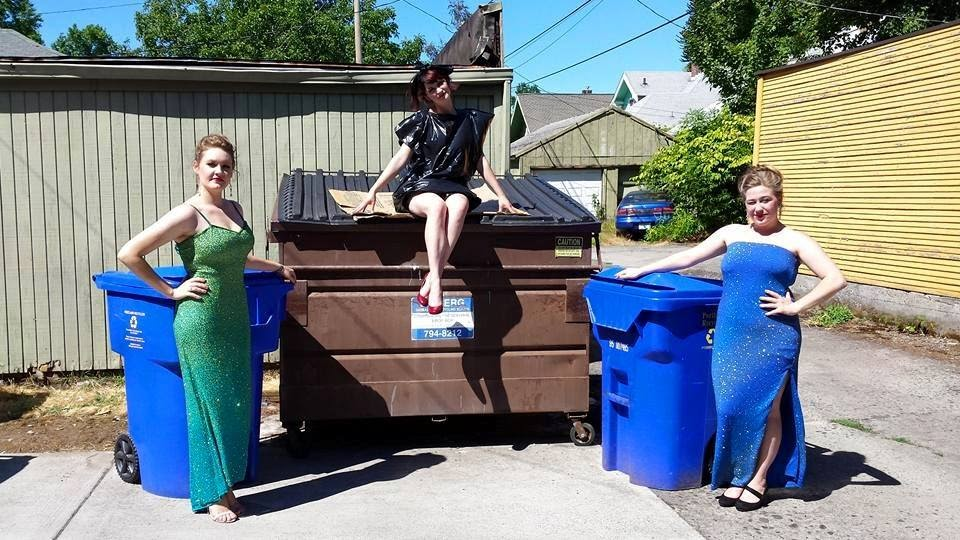 "McKenna Twedt, Brenan Dwyer, and Kaia Hillier (L to R) pose during filming of the final scene of ""I Love Pus"" as the most glamorous trash and recycling handlers you will ever encounter."