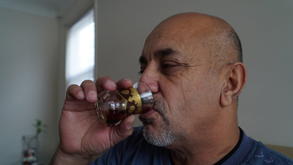 The Resettled - Jasem Al-Khalidi drinking Iraqi tea in Detroit, Michigan as a reminder of his home land.