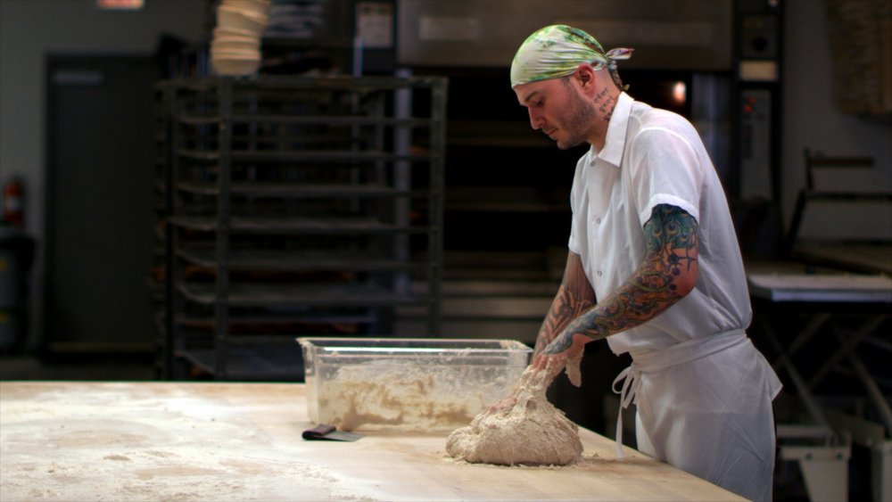 Sustainable - Artisan baker, Greg Wade, mixes his naturally fermented bread dough at Publican Quality Bread in Chicago, IL.