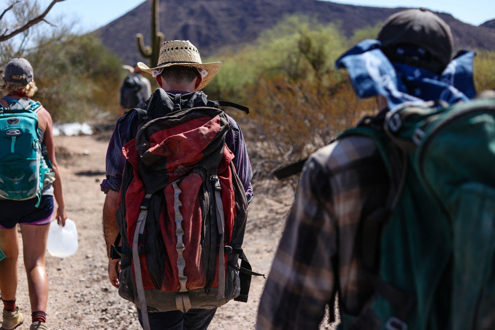 The Desert Walkers - Hat, check. Backpack, check. Water, check. Sunscreen, check.