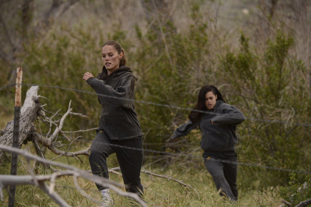 The Archer - Lauren (Bailey Noble) and Rebecca (Jeanine Mason) escape from the corrupt juvenile correctional facility, Paradise Trails.