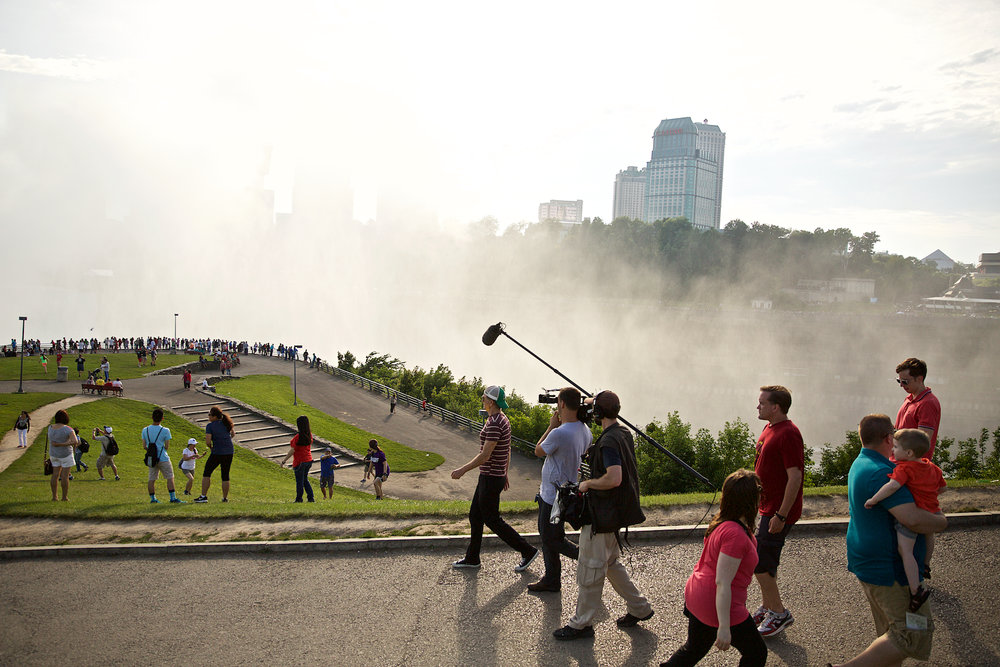 This is Happening: A Clean Energy Revolution - Writer/Director Jamie Redford filming at Niagra Falls.