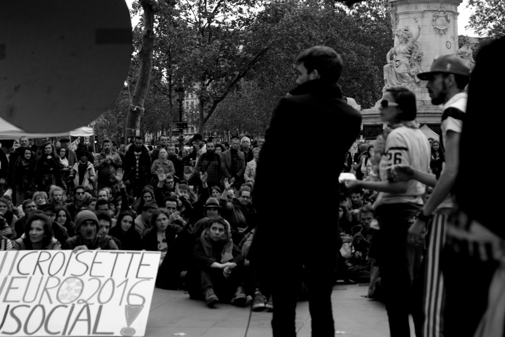 May 15th in Paris - A protester at Le Republic getting the crowd excited for the upcoming local city elections.