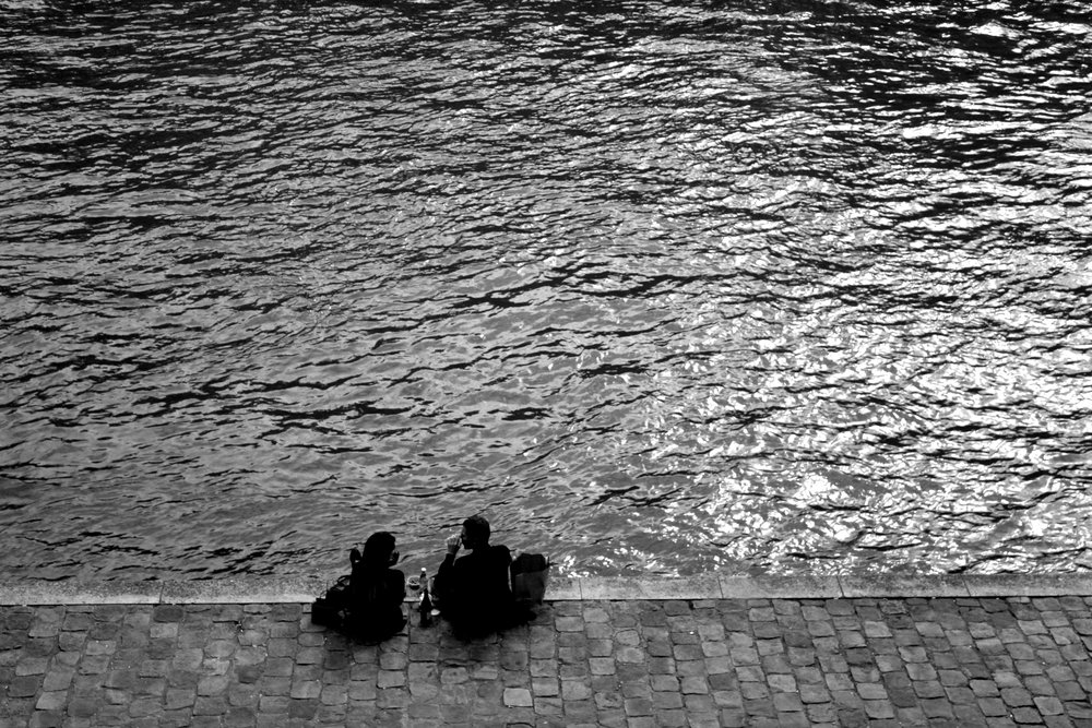 May 15th in Paris - A couple sitting together, enjoying the present moment in this beauty shot of Paris.