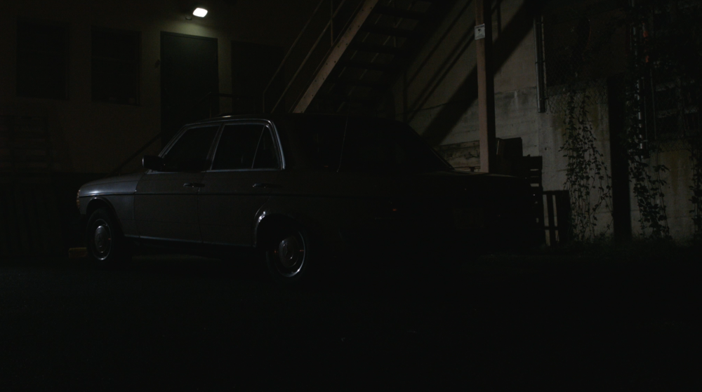 Fall of Night - The getaway car waits in the darkness.