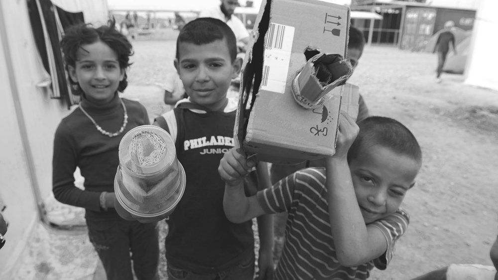 'A    group of children wandering around the refugee camp, playing documentary filmmakers and interviewing me with their cardboard camera and microphone.'