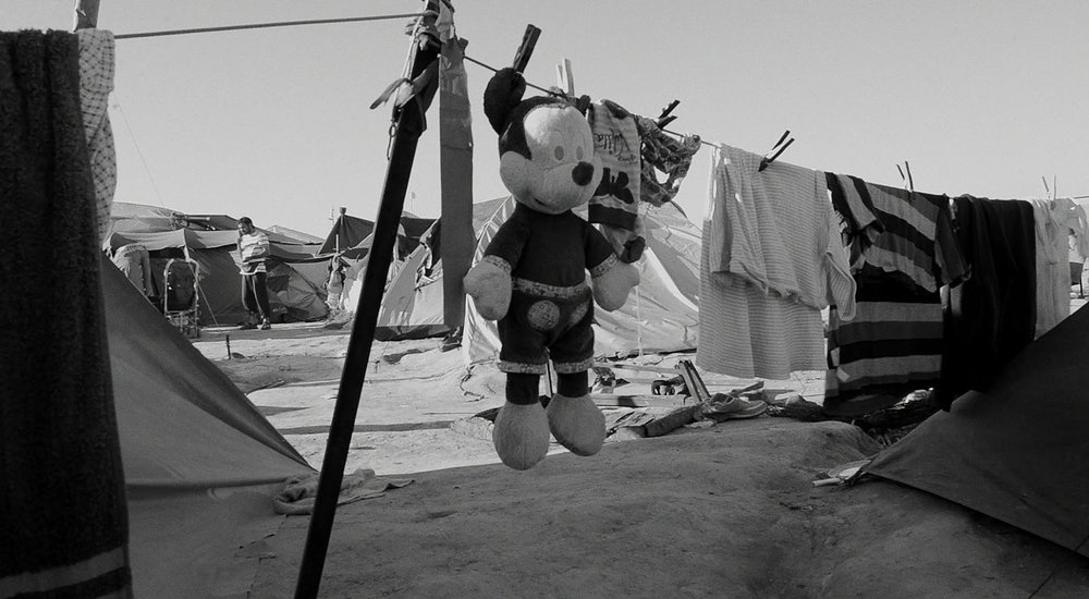 "'One third of the refugees in the Idomeni camp was under the age of 18.'     What type of impact and/or reception would you like this film to have?   The audience should feel outraged that refugees' basic human rights are not being respected. Refugees have the right to asylum. The majority of the refugees had a wonderful life that suddenly turned into a living hell. We all should feel much more than empathy; we should feel outrage. As contemporary philosopher Thomas Cristiano says, ""It is a fundamental duty of the international community to help out with the refugee problem. This means that one must accept some risk. Morality is never costless or risk-free. But we do owe it to our fellow human beings.""   What's a key question that will help spark a debate or begin a conversation about this film?   Being European, I know that my continent was devastated by two world wars. Many of us became refugees. Some Polish refugees in World War II fled to Iran to seek safety. It seems a remote thought, but what if this happened in our Country? How would we want to be treated if we were the refugees? Would we want the world to help us or to think of us as a threat and build a wall to keep us out?   Would you like to add anything else?   I entered Idomeni with some preconceptions generated by the media. I discovered a reality that was much more intricate, more human, because of the dignity, the sense of pride and communion, the great strength, the ability of still being able to smile, the endless hope of the refugees, and above all, their generosity. Walking around the camp, I was given fresh fruit and so many flowers.  One day I was leaving the camp and I heard a little girl screaming, ""My friend! My friend!"" (That's one of the few English expressions the children know and they use it all the time to attract the attention of the volunteers.) I thought, ""I hope this little girl is not coming to ask me for food or cookies because I've given everything away and have nothing to give her."" As she approached me she said, ""My friend, for you,"" and she offered me a little wild daisy and ran off through the fields.  After leaving the camps, I went to visit the Parthenon in Athens for the first time. It felt surreal to be in the country known as the cradle of civilization and democracy; centuries later it has been transformed into a purgatory for lost souls."