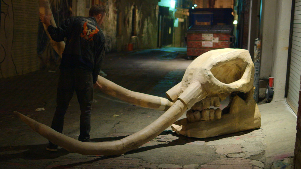 The Cardboard Artist -   Street artist Calder Greenwood installs a cardboard and paper mache mastodon skull in Downtown Los Angeles.
