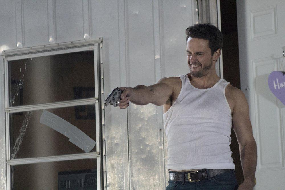 Boyd McFarland (Chris Johnson) menacing a beleaguered Jennifer.