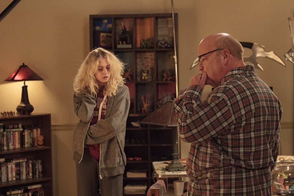 Penelope Mitchell and Kyle Gass (playing neighbor Terry Lumley) between takes.