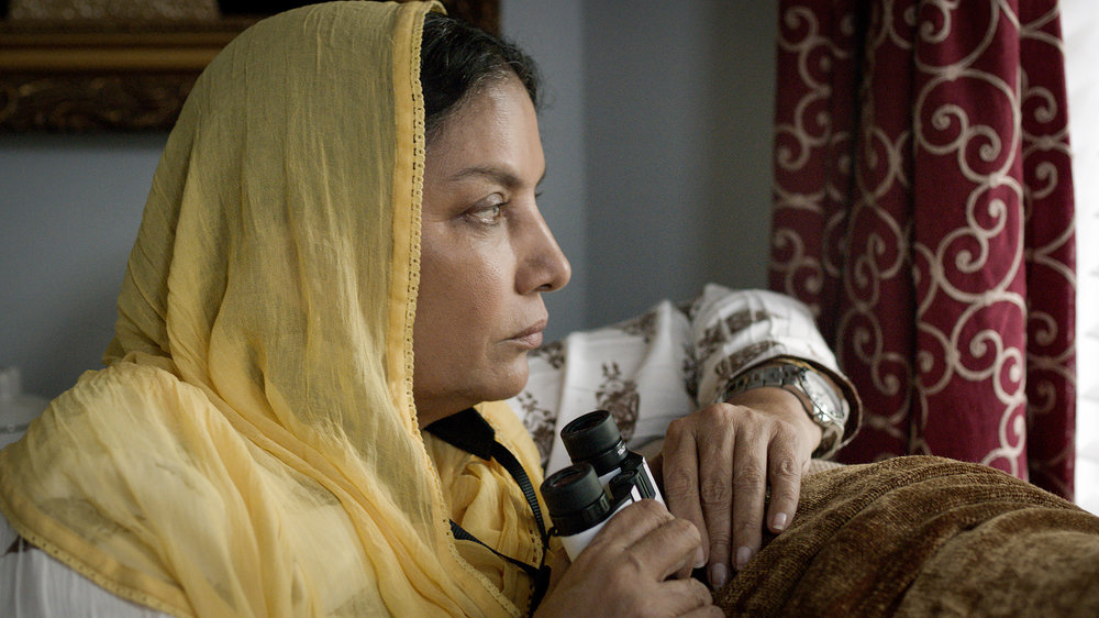 Signature Movie - Parveen (Shabana Azmi) seeks potentials through her window.