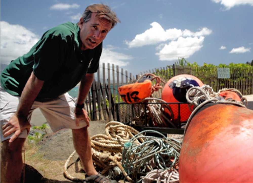 In the Wake of Giants - Ed Lyman sits with some of the gear removed from entangled whales.