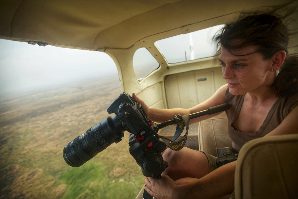 Director Kate Brooks filming over Garamba National Park in Democratic Republic of Congo. Copyright: The Last Animals