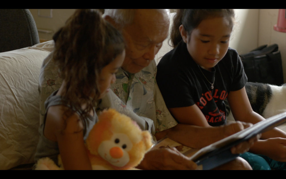 The Sakada Series - Angel Ramos, star of Living Treasure, with his grandchildren at his home in Kahuku.