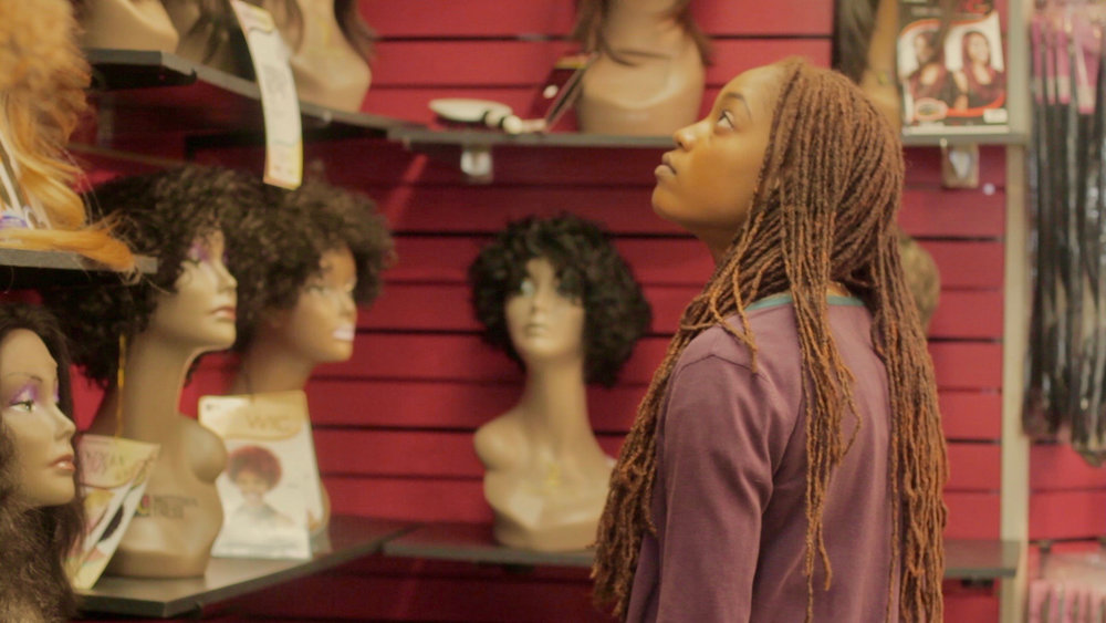 Like Fine Silk - Eva stares at mannequins in the beauty supply store