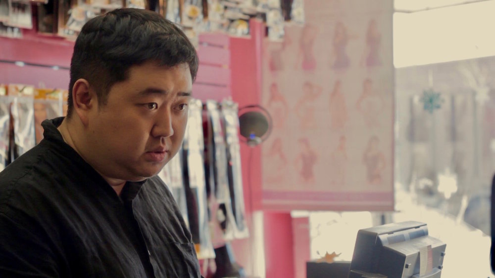Like Fine Silk - The store owner questioning the main characters about their background.