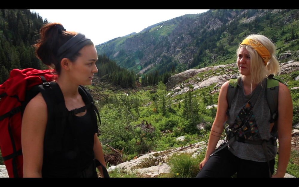 hasing Shadow - Jules (Melanie Stone) and Ainsley (Hailey Nebeker) debate the ramifications of their otherworldly sighting in the mountains.