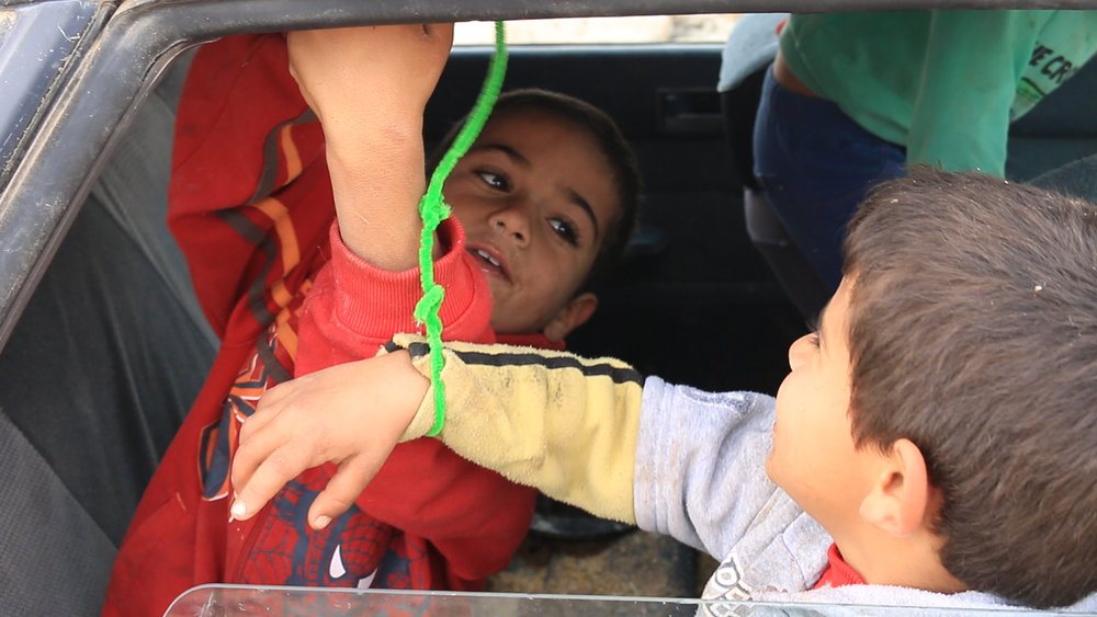 Objector - Palestinian children playing with fake handcuffs