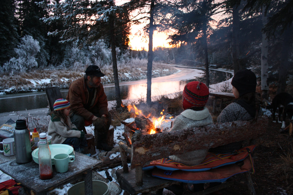 All The Time In The World - Family relaxing by campfire in the bush - late Fall