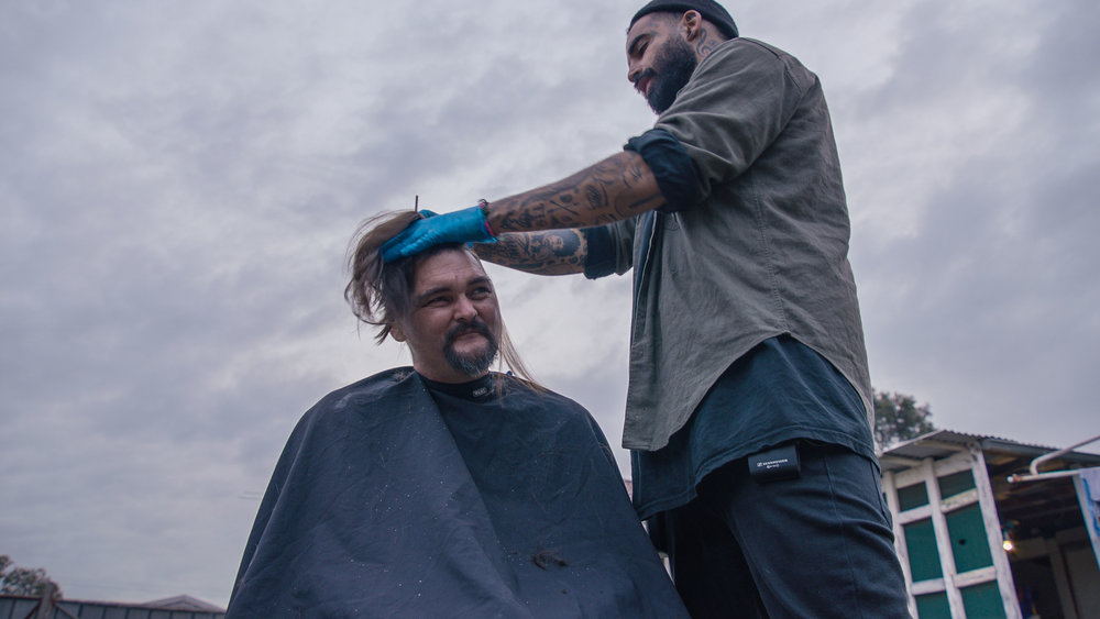 The Streets Barber Stories - Aaron, beaming with positivity now, having lived through a past of drug abuse and homelessness.