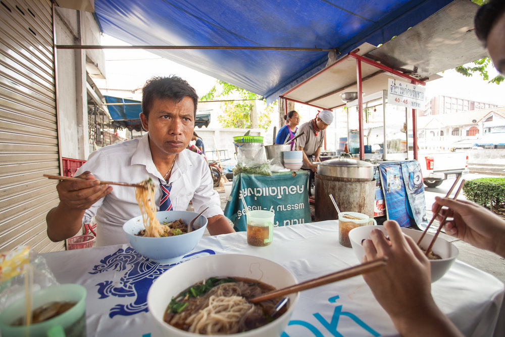 Bazaar Taxi -Narong eating noodles at one of his favourite destinations in Bangkok 'Chicken Noodle by Papa Karn'