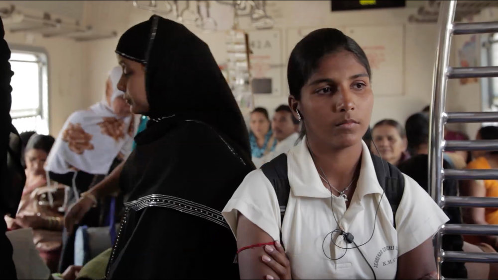 Kaikasha Mirza (right) rides the train to cricket practice from her predominantly Muslim neighborhood in Mumbai, India. From the feature documentary, Purdah. Dir. Jeremy Guy. Image courtesy of Jeremy Guy Films, LLC.