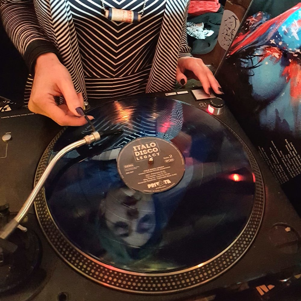 Dj Licia spinning Italo Disco Legacy soundtrack on vinyl, released by Private Records