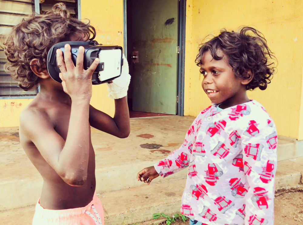 Kids playing with a VR headset.png