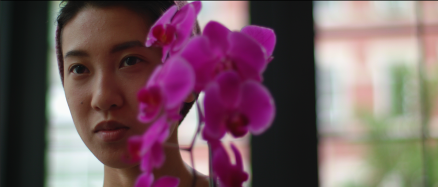 Jes Tom and her co-star (a moth orchid) during filming. Photo credit: Dan McBride