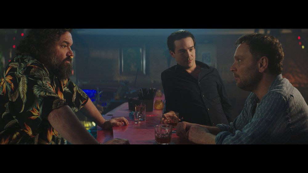 Barry just wants to finish his drink at the bar, but Chris has other plans. Bartender (L) – Toby Hargrave, Chris (M) – Kett Turton, Barry (R) - Ben Cotton