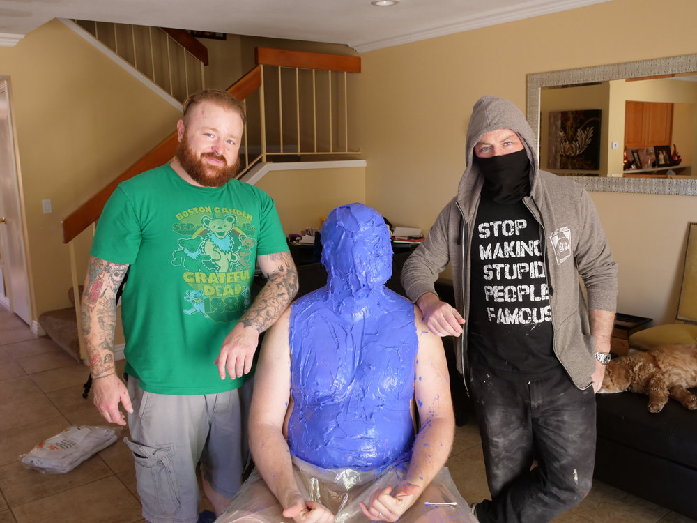 "Joshua ""Ginger"" Monroe, Matt (Harvey Weinstein statue model), Plastic Jesus pose during lifecasting session"