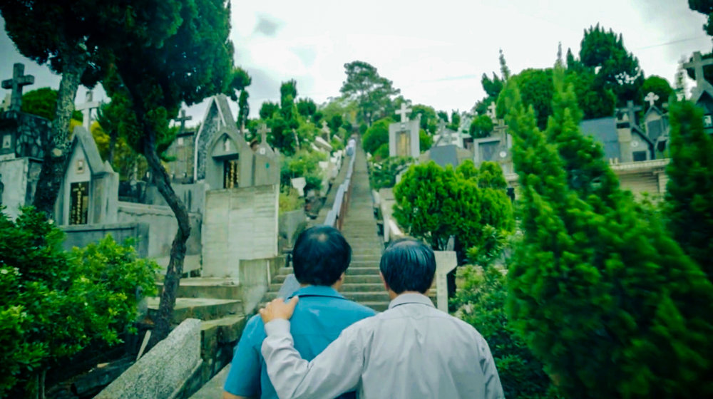 Arthur and his father attempting reconciliation. Visiting his grandfather's grave.
