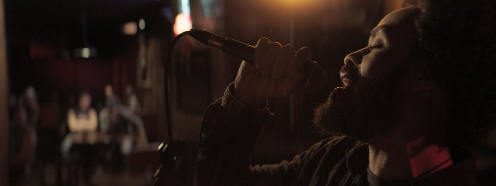 """Grammy award winning artist  Bilal  shines with a brilliant and raw performance of the films original theme song """"Enough""""."""