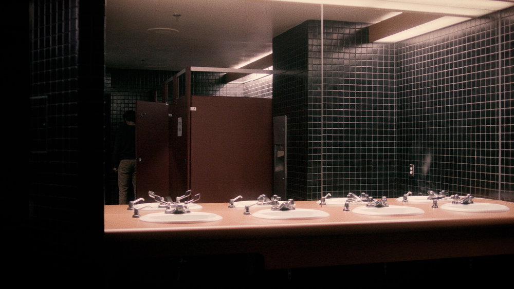Woman in Stall
