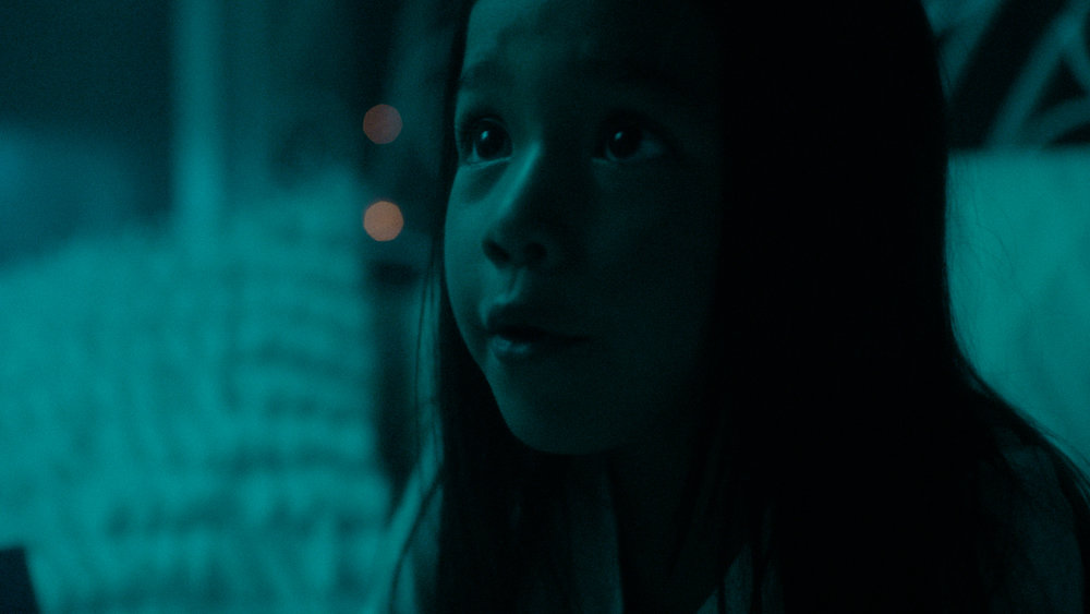 Production Still: Mai Brunelle as Young Ella. Cinematography by Logan Triplett, Color Grading by Ayumi Ashley.