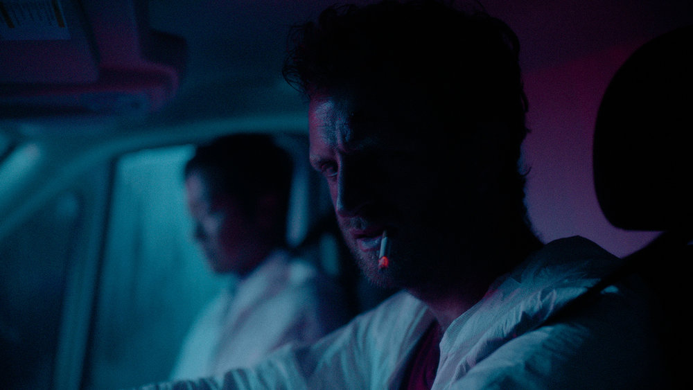 Production Still: Aaron Glenane as Mason and Nathan Lee as Lee. Cinematography by Logan Triplett, Color Grading by Ayumi Ashley.