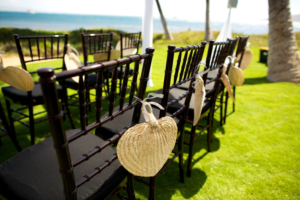 Maui wedding ceremony chairs with woven fan favors by Bliss Weddings