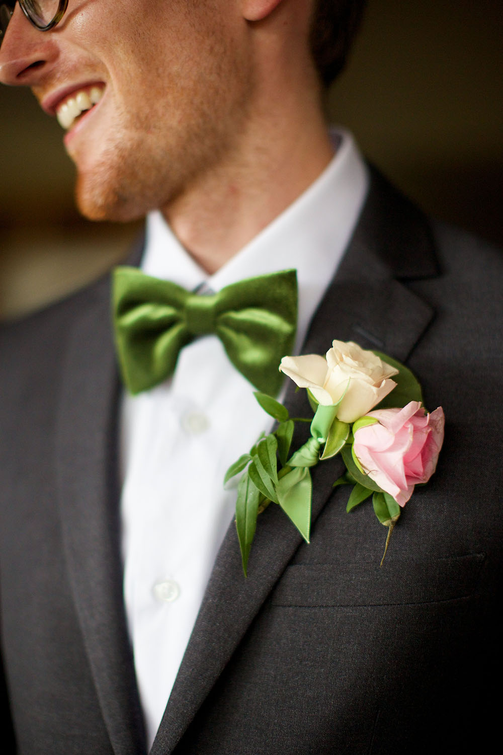 Stylish groom with a pink rose boutonniere and green velvet bow tie - Bliss Wedding Design and Anna Kim Photography