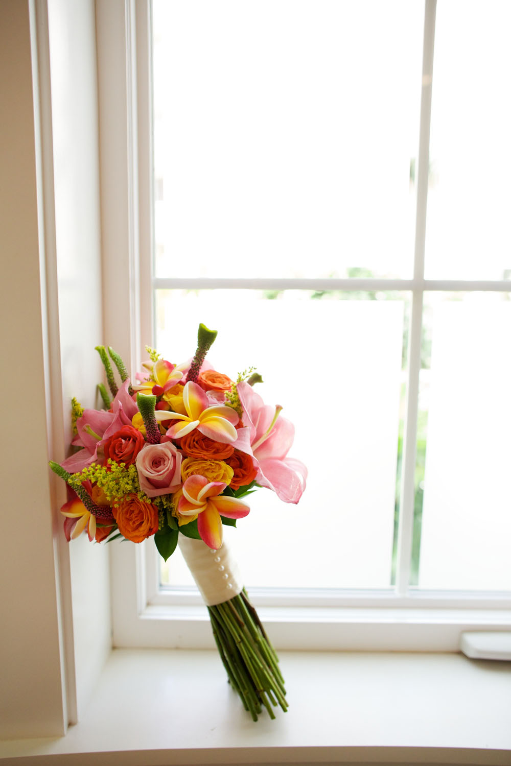 Bright tropical wedding bouquet by Bliss Wedding Design - photo by Anna Kim Photography