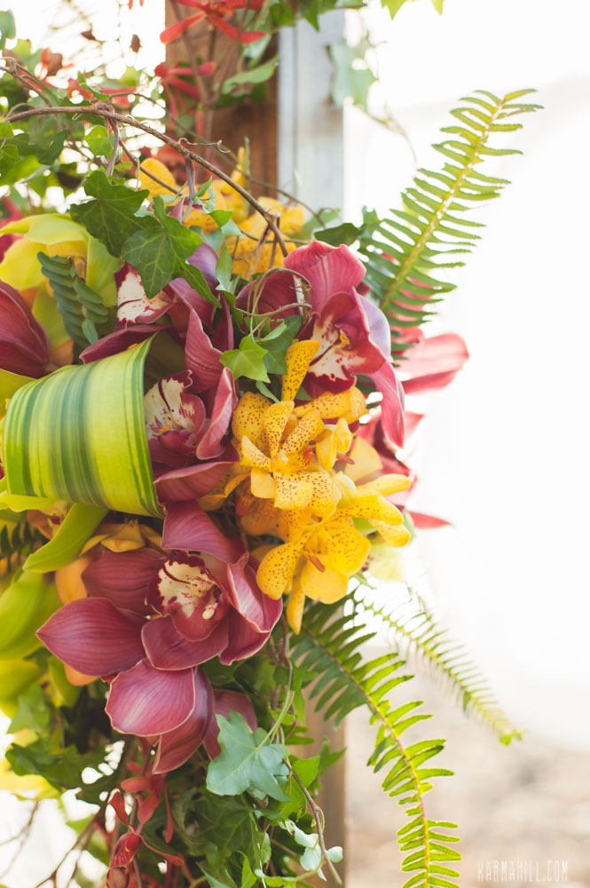 Tropical wedding ceremony arch by Bliss Wedding Design - photo by Karma Hill Photography