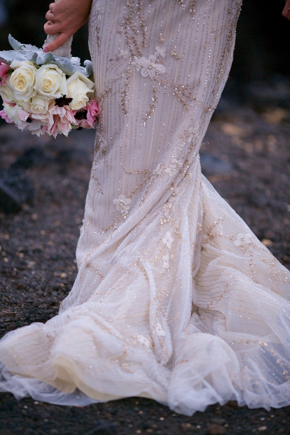 romantic beaded wedding dress and bouquet